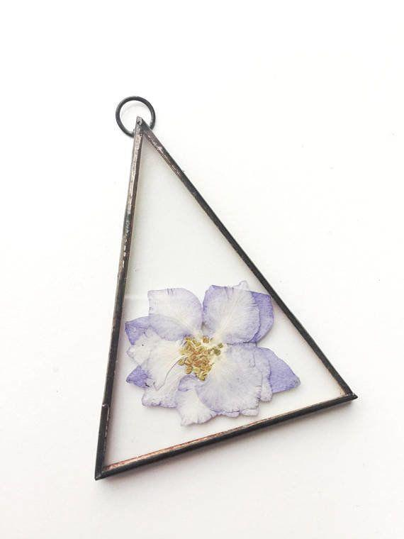 "Get it from <a href=""https://www.etsy.com/listing/579175666/glass-pressed-flower-frame-triangle?ga_order=most_relevant&ga_search_type=all&ga_view_type=gallery&ga_search_query=real%20pressed%20flower%20wall%20hanging&ref=sr_gallery-1-6"" target=""_blank"">Paly Glass on Etsy, $14</a>."