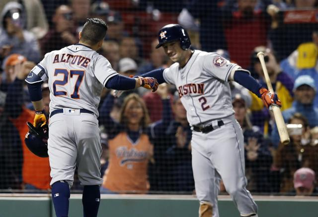 Houston Astros' Jose Altuve (27) celebrates his solo home run with Alex Bregman (2) during the sixth inning of a baseball game against the Boston Red Sox in Boston, Sunday, Sept. 9, 2018. (AP Photo/Michael Dwyer)