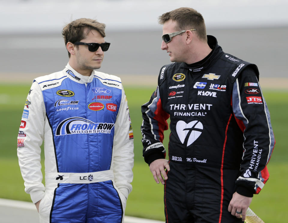 Landon Cassill (L) is being replaced by the man on the right. (AP Photo/Terry Renna, File)