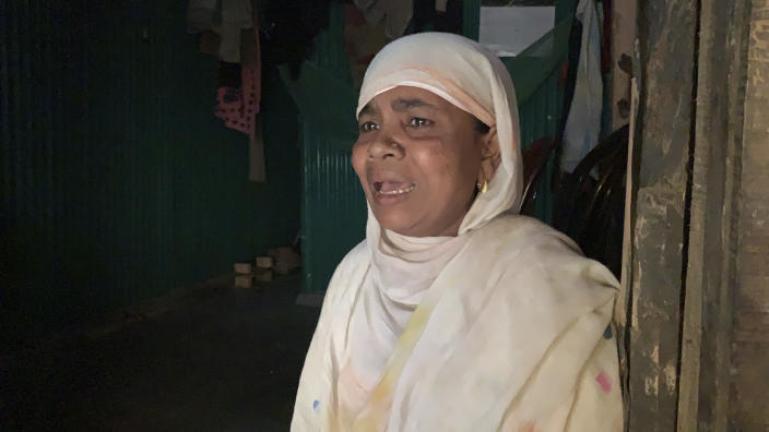 """Rohingya refugee Nasima Khatun, mother of a 25-year-old man stranded on a boat, speaks with the Associated Press at Kutupalong refugee camp in Cox's Bazar district, Bangladesh, Wednesday, Feb. 24, 2021. A group of Rohingya refugees is adrift in a boat in the Andaman Sea without food or water, the United Nations said Wednesday, as their families worried that many may have already died. """"Oh Allah, save all of the people that are stuck in the boat including my son with your divine magic. Put them somewhere on the coast of the river. Please fulfill the wishes of my son to go there,"""" said Khatun. (AP Photo/Shafiqur Rahman)"""