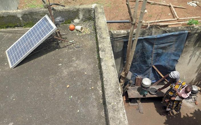 """A solar-powered cooker, called """"Mivo"""", which means """"Take it easy"""" in the local Fon language -- has been marketed by a charity called Autre Vie in Porto-Novo (AFP Photo/)"""