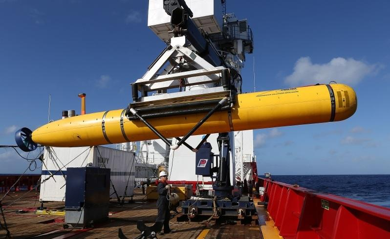 an autonomous underwater vehicle is craned over the side of the ocean shield in the search for missing malaysia airlines flight mh 370 . picture: adf