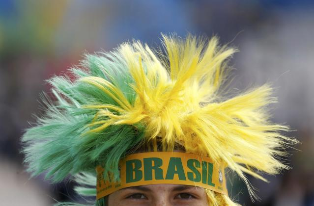 A supporter of Brazil's national soccer team arrives for the opening match of the soccer World Cup between Brazil and Croatia at the Arena de Sao Paulo in Sao Paulo June 12, 2014. REUTERS/Kai Pfaffenbach (BRAZIL - Tags: HEADSHOT SOCCER SPORT WORLD CUP)