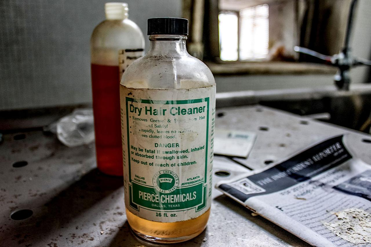 <p>A bottle of dry hair cleaner in the abandoned funeral home in Jacksonville, Fla. (Photo: Abandoned Southeast/Caters News) </p>