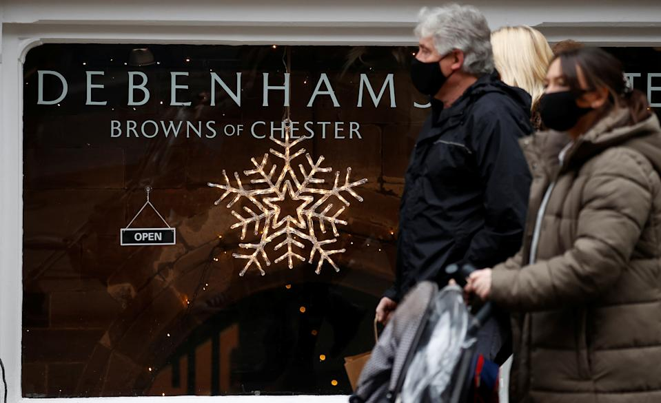 Shoppers walk past a Debenhams store in Chester, Britain. Photo: Phil Noble/Reuters