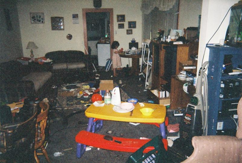 The teenager shared her story on Reddit along with this photo of the lounge room of her home, which had rubbish scattered everywhere.