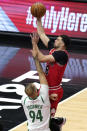 Chicago Bulls guard Zach LaVine, top, drives to the basket against Boston Celtics guard Evan Fournier during the first half of an NBA basketball game in Chicago, Friday, May 7, 2021. (AP Photo/Nam Y. Huh)