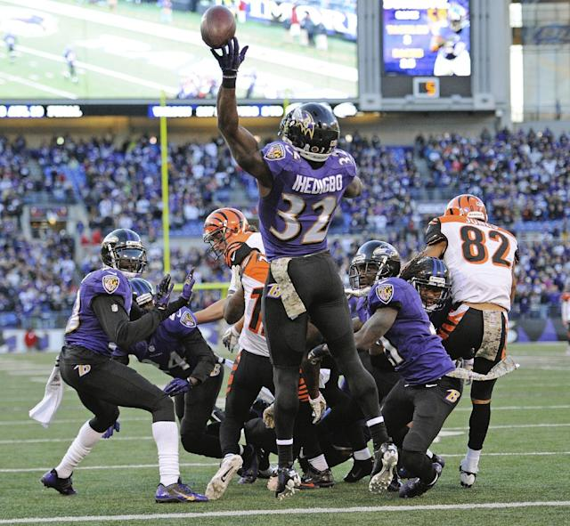 Baltimore Ravens strong safety James Ihedigbo tips the ball into the air sending it into the hands of Cincinnati Bengals wide receiver A.J. Green for a touchdown during the second half of a NFL football game in Baltimore, Sunday, Nov. 10, 2013. (AP Photo/Nick Wass)