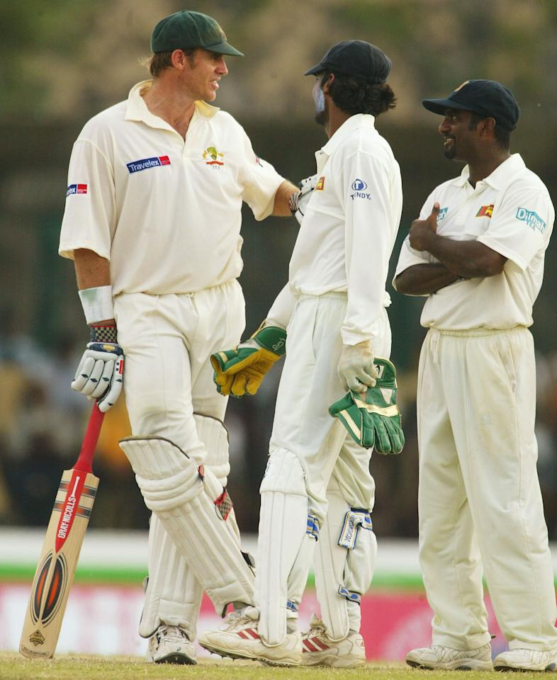 GALLE,SRI LANKA - MARCH 10:  Matthew Hayden of Australia exchanges words with Kumar Sangakkara and Muttiah Muralitharan of Sri Lanka after the run out of Ricky Ponting of Australia during day three of the First Test between Australia and Sri Lanka played at the Galle International Cricket Stadium on March 10, 2004 in Galle, Sri Lanka. (Photo by Hamish Blair/Getty Images)