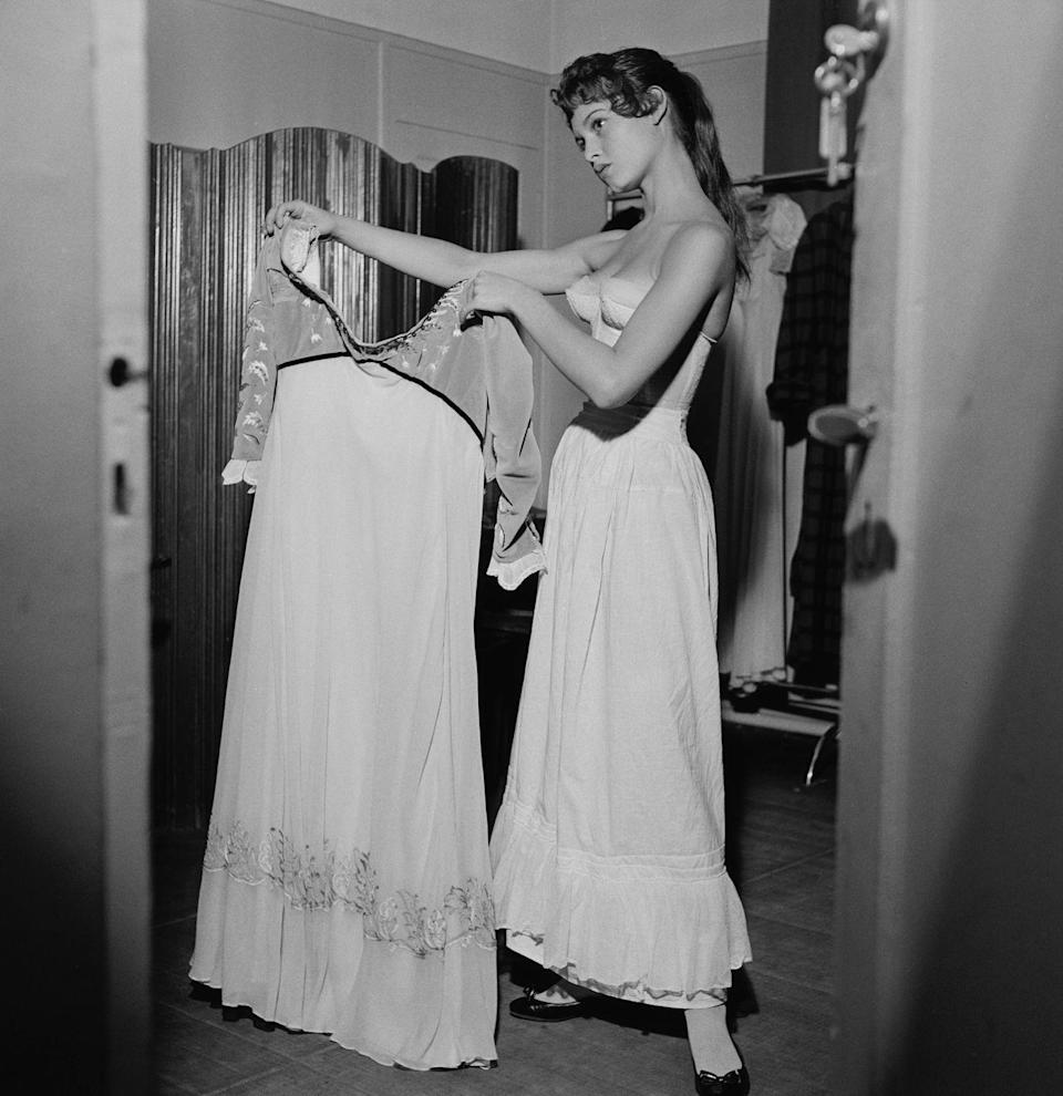 <p>The actress and model prepares for a wardrobe change backstage at the play <em>L'Invitation au Chateau</em>.</p>