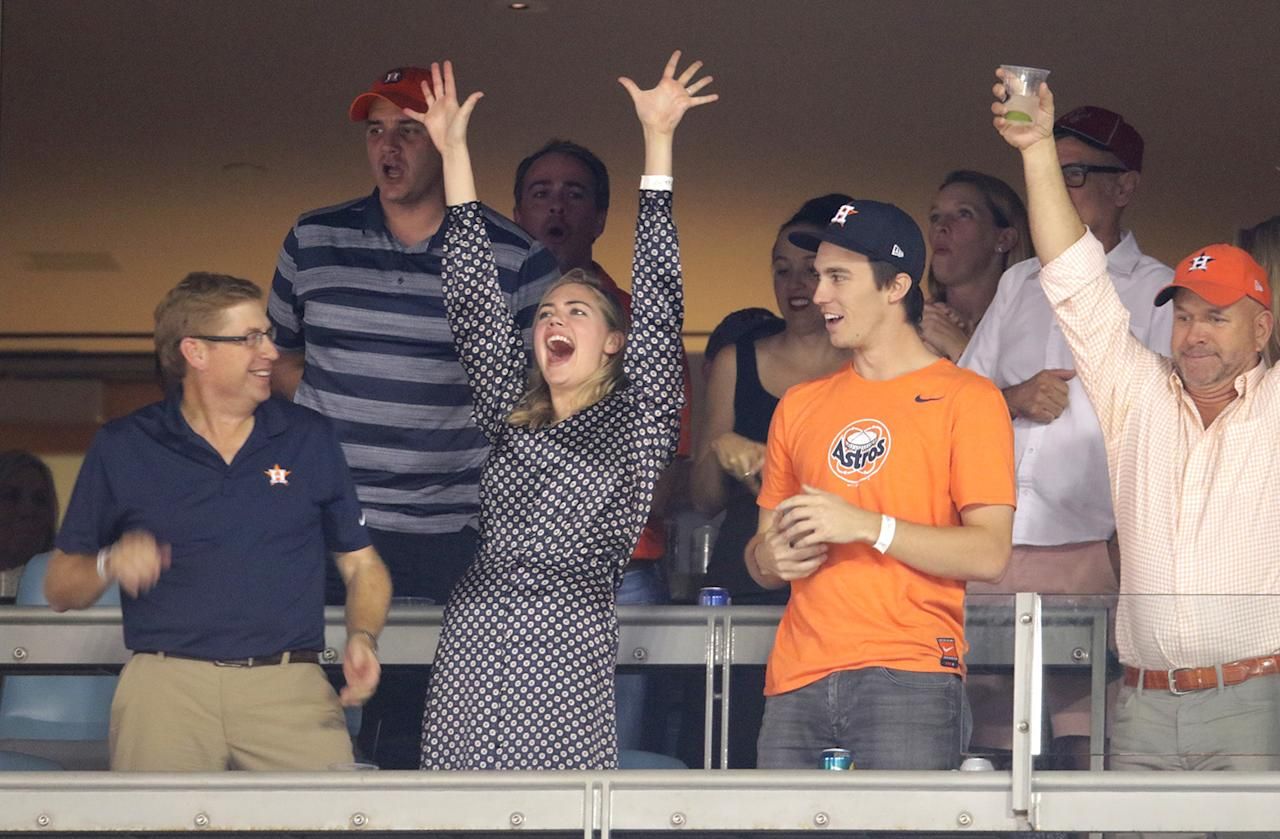 <p>Model Kate Upton is an Astros fan, naturally, as fiancé Justin Verlander is a pitcher for the team. While she always has a great seat, she rarely sits down on one! (Photo: Jerritt Clark/Getty Images) </p>