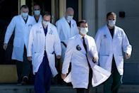 White House physician Sean Conley (2nd R), with medical staff, arrives to give an update on the condition of US President Donald Trump, on October 3, 2020, at Walter Reed Medical Center in Bethesda, Maryland