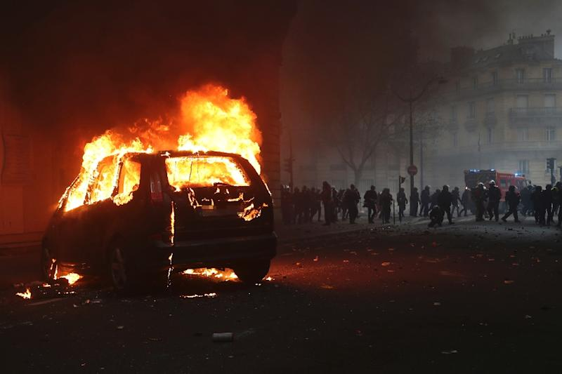 A car burning overnight during demonstrations in Paris which saw police and protesters clash (AFP Photo/Zakaria ABDELKAFI)