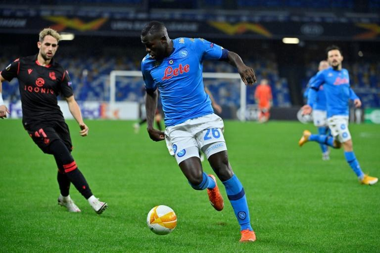 Napoli's Senegalese defender Kalidou Koulibaly (c) got the first goal after five minutes in Naples.