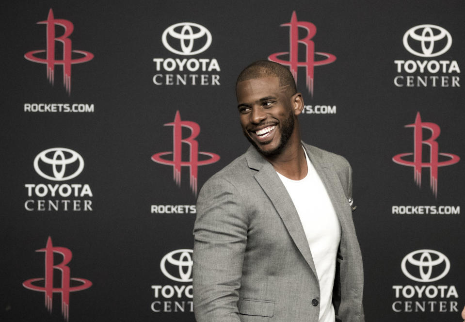 Chris Paul sure looks happy to be on the Houston Rockets now. (AP)
