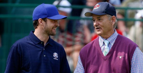 Hollywood stars Justin Timberlake and Bill Murray chat on the first tee during the 2012 Ryder Cup Captains & Celebrity Scramble at Medinah Country Golf Club on September 25, 2012 in Medinah, Illinois.