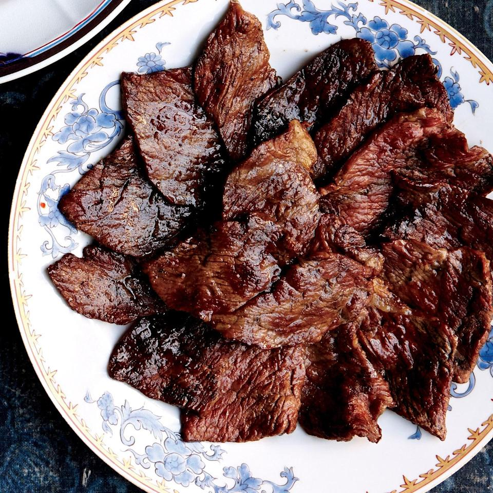 """Edward Kim, of Mott St in Chicago, grills brisket with no seasoning at all. Freezing this brisket will help you get the easiest, most even slices. <a href=""""https://www.epicurious.com/recipes/food/views/grilled-sliced-brisket-51239920?mbid=synd_yahoo_rss"""" rel=""""nofollow noopener"""" target=""""_blank"""" data-ylk=""""slk:See recipe."""" class=""""link rapid-noclick-resp"""">See recipe.</a>"""