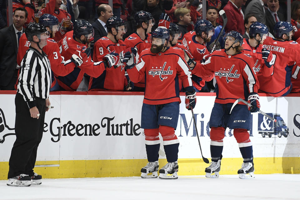 Washington Capitals defenseman Radko Gudas (33) celebrates his goal with the bench during the second period of an NHL hockey game against the Tampa Bay Lightning, Saturday, Dec. 21, 2019, in Washington. (AP Photo/Nick Wass)