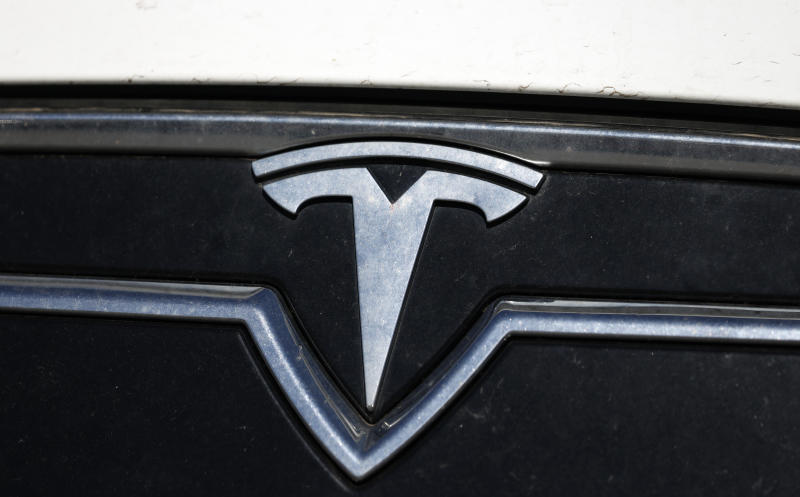 the company logo shones off the grille of an unsold 2020 Model S sedan at a Tesla dealership Sunday, July 19, 2020, in Littleton, Colo. (AP Photo/David Zalubowski)