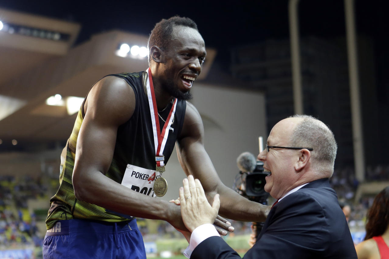 Jamaica's Usain Bolt shares a laugh with Prince Albert of Monaco during the podium ceremony after winning the men's 100m race at the IAAF Diamond League Athletics meeting at the Louis II Stadium in Monaco, Friday, July 21, 2017. Eight-time Olympic champion Usain Bolt competes in his final Diamond League meeting ahead of next month's world championships and his impending retirement.(AP Photo/Claude Paris)