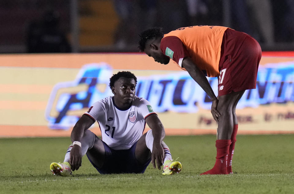 Panama's Freddy Gondola, right, talks with United States´ George Bello at the end of a qualifying soccer match for the FIFA World Cup Qatar 2022 at Rommel Fernandez stadium, in Panama city, Panama, Sunday, Oct. 10, 2021. Panama won 1-0. (AP Photo/Arnulfo Franco)
