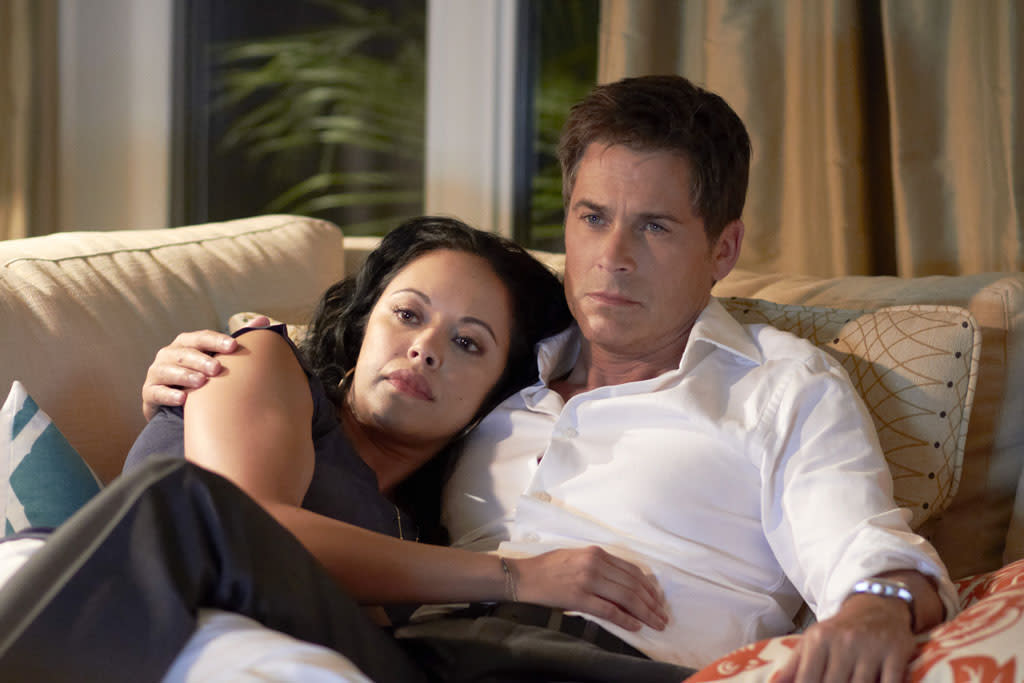 "Marisa Ramirez (Rita Brockway Ashton) and Rob Lowe (Jeff Ashton) in the Lifetime Original Movie, ""Prosecuting Casey Anthony."""