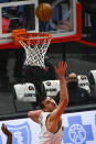 Denver Nuggets center Nikola Jokic shoots against the Chicago Bulls during the first half of an NBA basketball game Monday, March 1, 2021, in Chicago. (AP Photo/Matt Marton)