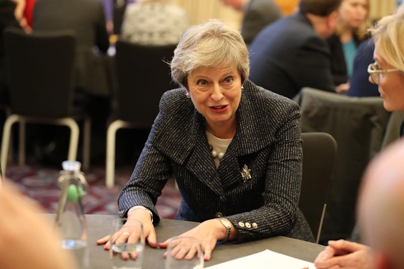 Theresa May pushes her plan on a trip to Belfast (Photo: PA Ready News UK)