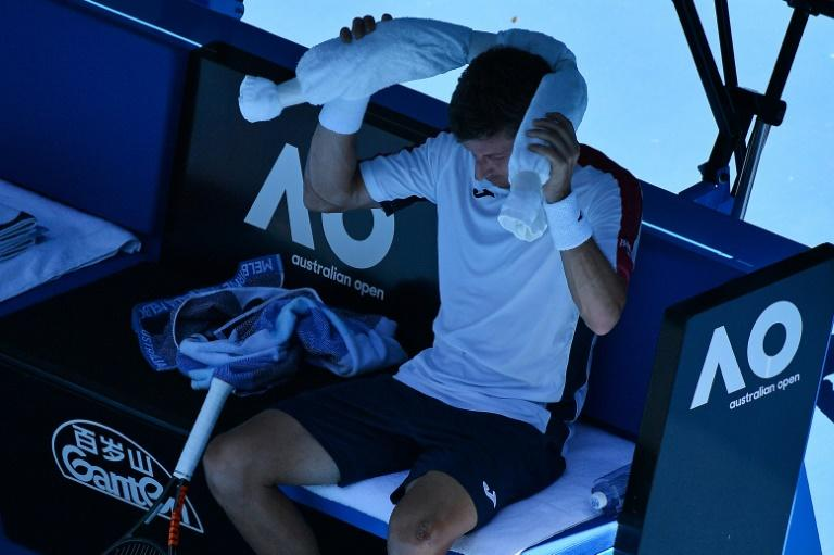 Spain's Pablo Carreno Busta cools down during a break while playing against Luxembourg's Gilles Muller during their Australian Open third round match, in Melbourne, on January 19, 2018
