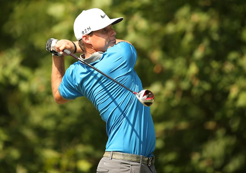 Nick Watney plays his tee shot on the 13th hole during the third round of the Wyndham Championship, at Sedgefield Country Club in Greensboro, North Carolina, on August 16, 2014