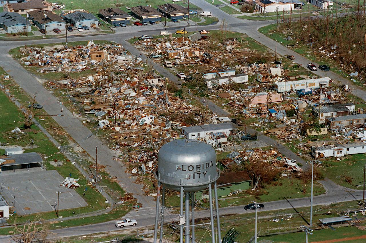 <p>This water tower, shown Aug. 25, 1992, a landmark at Florida City, Fla., still stands over the ruins of the Florida coastal community that was hit by the force of Hurricane Andrew. The storm damage to the South Florida area was estimated at $15 billion, leaving about 50,000 homeless. (AP Photo/Ray Fairall) </p>