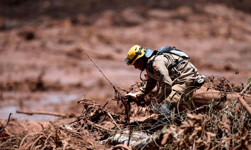A rescuer searches for victims of the dam collapse near the town of Brumadinho, Brazil, on 28 January 2019
