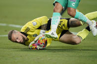 Seattle Sounders goalkeeper Stefan Frei (24) stops the ball against Club Leon during the first half of the Leagues Cup soccer final Wednesday, Sept. 22, 2021, in Las Vegas. (AP Photo/John Locher)