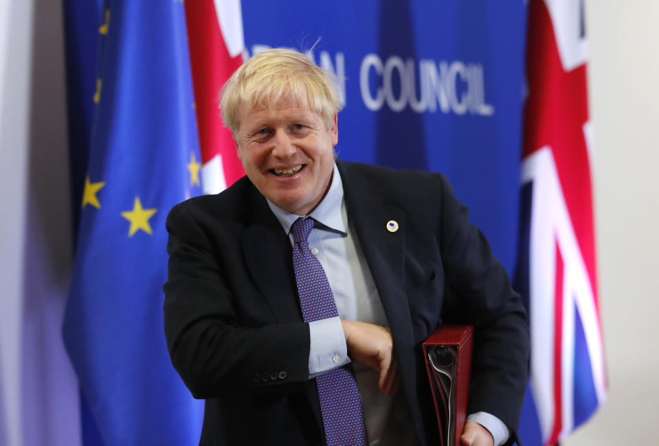 British Prime Minister Boris Johnson leaves the podium after addressing a media conference at an EU summit in Brussels, Thursday, Oct. 17, 2019. Britain and the European Union reached a new tentative Brexit deal on Thursday, hoping to finally escape the acrimony, divisions and frustration of their three-year divorce battle. (AP Photo/Frank Augstein)