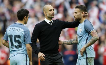 Britain Football Soccer - Arsenal v Manchester City - FA Cup Semi Final - Wembley Stadium - 23/4/17 Manchester City manager Pep Guardiola, Jesus Navas and Nicolas Otamendi look dejected after the match Action Images via Reuters / Carl Recine Livepic
