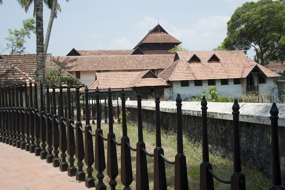 <strong>Central mansion: </strong>The four-storeyed building is located at the centre of the palace complex. The ground floor houses the royal treasury. The first floor houses the King's bedrooms. The ornamental bedstead is made of 64 types of herbal and medicinal woods, and was a gift from the Dutch merchants. Most of the rooms here and in other parts of the palace complex have built-in recesses in walls for storing weapons like swords and daggers.