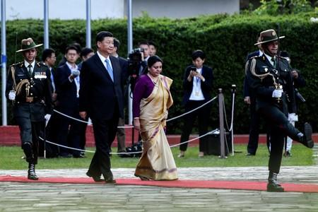 Nepal's President Bidhya Devi Bhandari and China's President Xi Jinping inspect an honor guard during a welcome ceremony at the Tribhuvan International Airport in Kathmandu