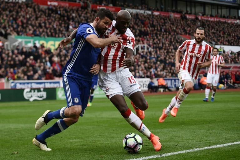Chelsea's striker Diego Costa (L) vies with Stoke City's defender Bruno Martins Indi during the English Premier League football match March 18, 2017
