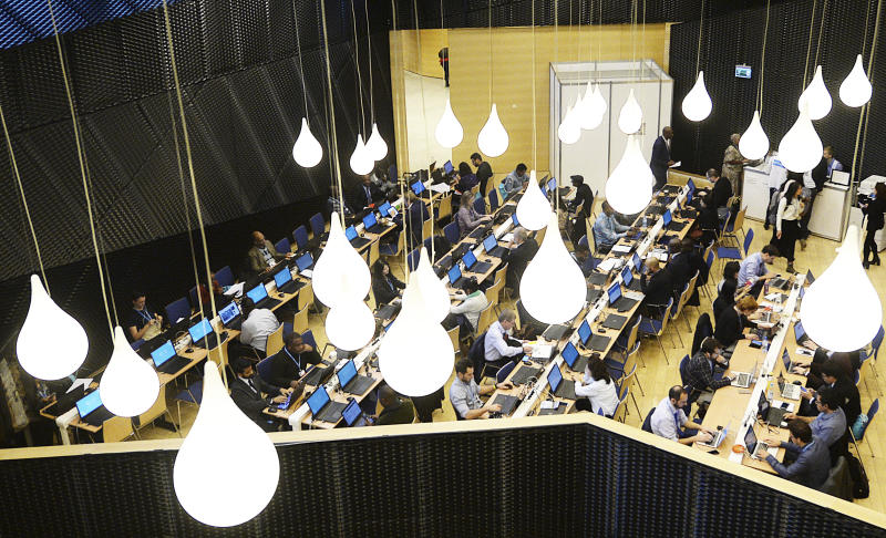 Participants work in a computer room during the Climate Change Conference COP24 in Katowice, Poland, Tuesday, Dec. 4, 2018. (AP Photo/Czarek Sokolowski)