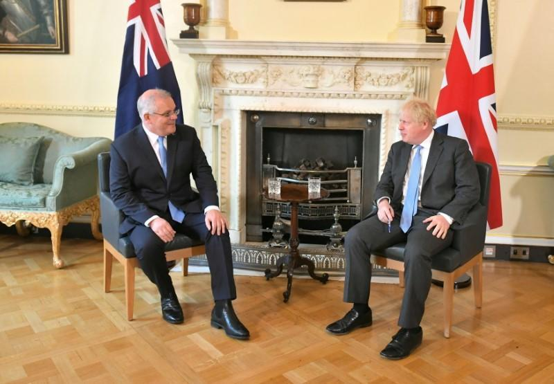 Britain's PM Johnson and Australia's PM Morrison meet ahead of trade deal announcement, in London