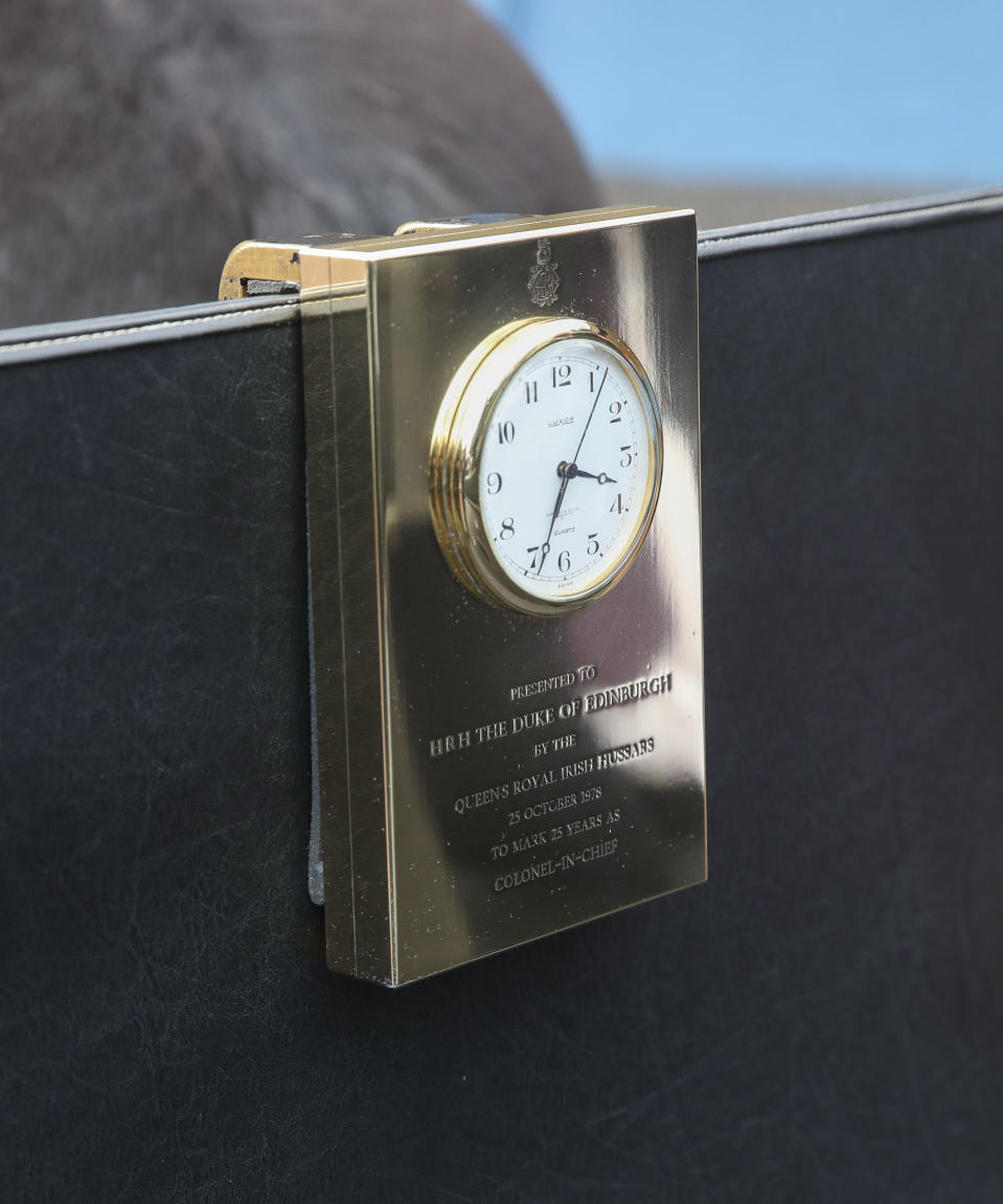 The clock and plaque on the driving carriage used by Philip