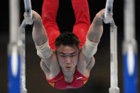 China's Sun Wei performs on the parallel bars during the men's artistic gymnastic qualifications at the 2020 Summer Olympics, Saturday, July 24, 2021, in Tokyo. (AP Photo/Gregory Bull)