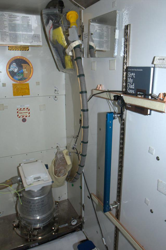 Space Station Toilet - it uses airflow, and solids/liquids are done separately. Note the ironic reading material.
