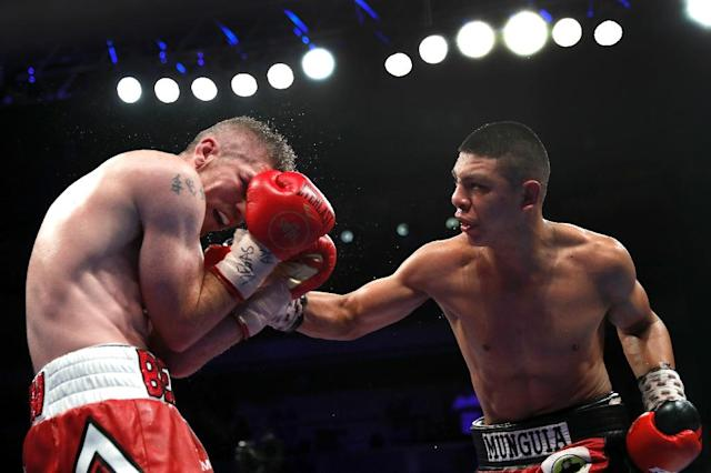 WBO junior middleweight champion Jaime Munguia (R) of Mexico improved to 30-0 with 25 knockouts by becoming just the second boxer to beat Liam Smith of England (L) (AFP Photo/Steve Marcus)