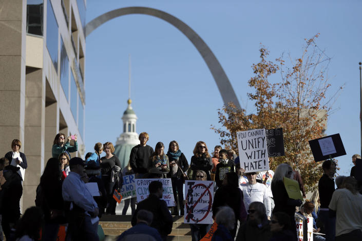 <p>Protesters hold signs as they prepare to march in opposition to the election of President-elect, Donald Trump Sunday, Nov. 13, 2016, in St. Louis. (AP Photo/Jeff Roberson) </p>