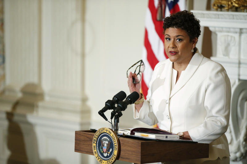FILE - In this April 17, 2015 file photo, poet laureate Elizabeth Alexander gives a poetry reading in the State Dining Room of the White House in Washington. On Thursday, July 25, 2019, Darren Walker as president of the Ford Foundation and Alexander, president of the Andrew W. Mellon Foundation, shepherded a $30 million deal to buy the photo archive of Ebony and Jet, America's most iconic black magazines.  (AP Photo/Andrew Harnik, File)