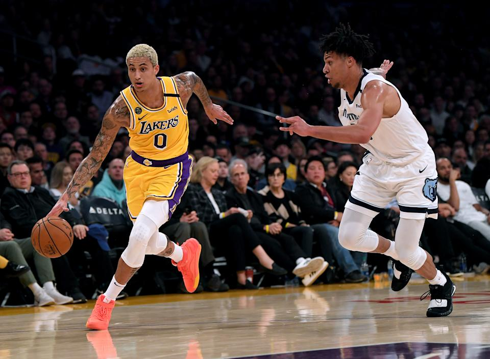 LOS ANGELES, CALIFORNIA - FEBRUARY 21:  Kyle Kuzma #0 of the Los Angeles Lakers dribble past Brandon Clarke #15 of the Memphis Grizzlies at Staples Center on February 21, 2020 in Los Angeles, California.  NOTE TO USER: User expressly acknowledges and agrees that, by downloading and or using this photograph, User is consenting to the terms and conditions of the Getty Images License Agreement. (Photo by Harry How/Getty Images)
