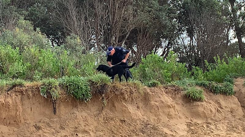 Police are searching the surrounding sand dunes using a cadaver dog. Source: Yahoo News Australia / Michael Dahlstrom