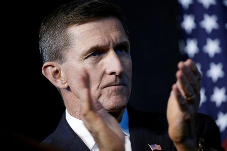 FILE PHOTO: Retired U.S. Army Lieutenant General Michael Flynn reacts at a campaign event for then Republican presidential nominee Donald Trump in Herndon