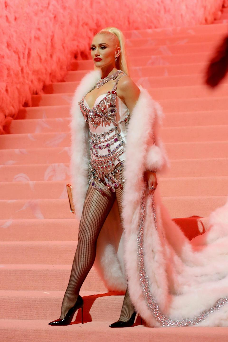 <p>At the 2019 Met Gala, Gwen completed this Moschino by Jeremy Scott look with Christian Louboutin patent pumps.</p>